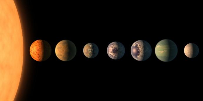 트라피스트 항성계의 상상도. 행성 7개 중 6개가 지구와 유사한 환경일 것으로 예상하고 있다. - NASA 제공